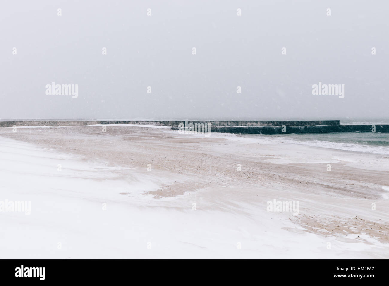 Beach during a blizzard and snowfall, minimalist landscape, soft focus - Stock Image