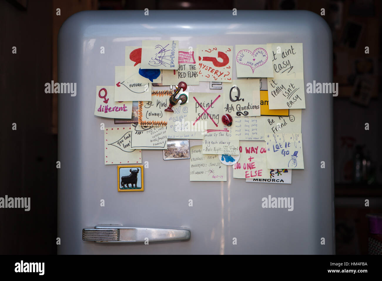 SMEG fridge covered with relationship tips post-it's - Stock Image