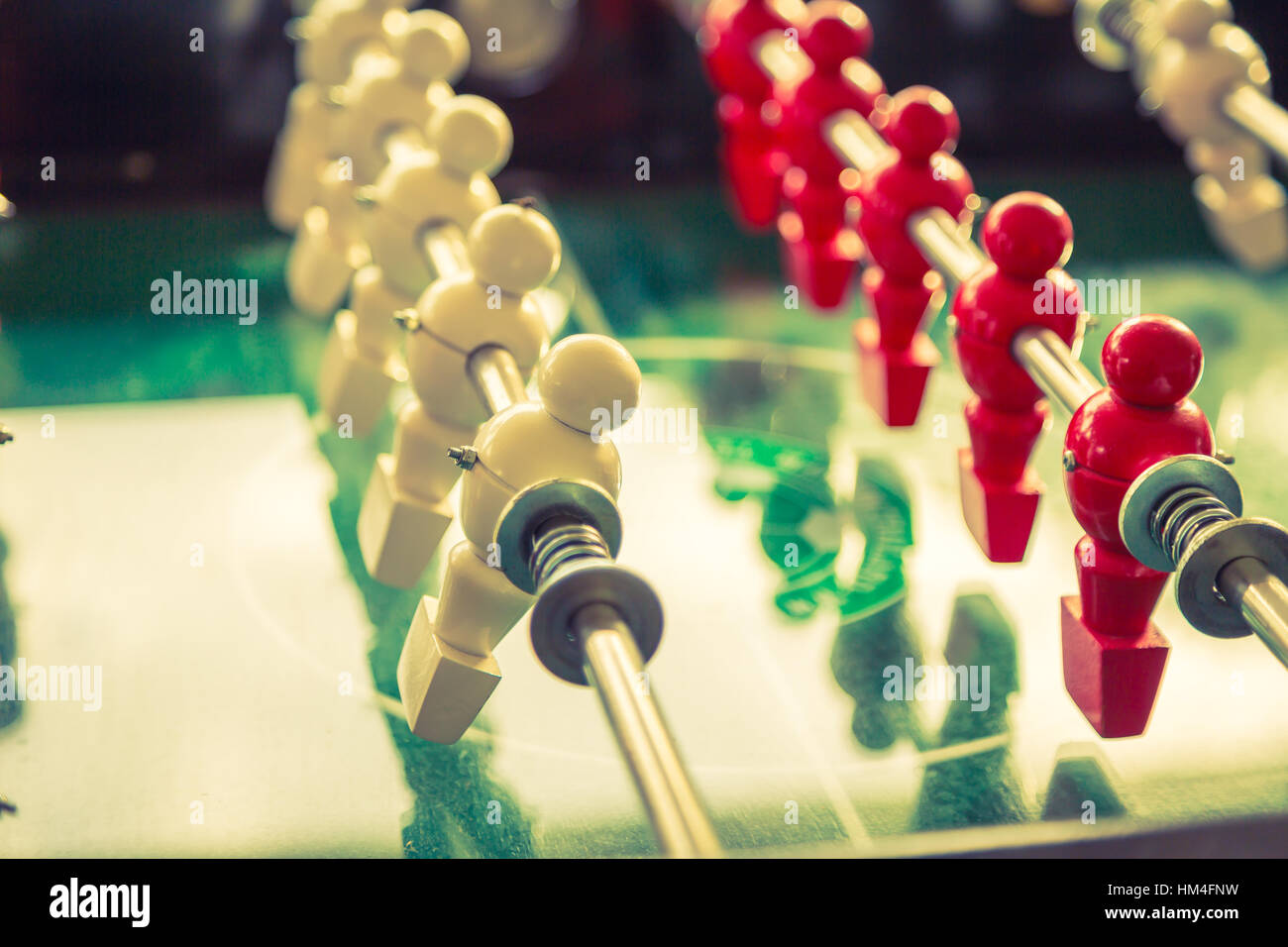 Football table game with red and white player ( Filtered image processed vintage effect. ) - Stock Image