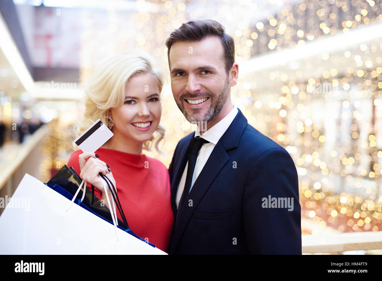 Portrait of pretty couple in the shopping mall - Stock Image