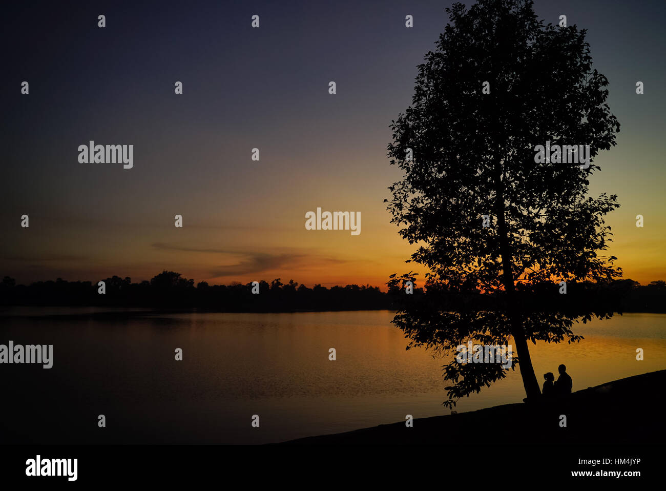 Sunset at one of the many lakes in Angkor Siem Riep province Cambodia - Stock Image