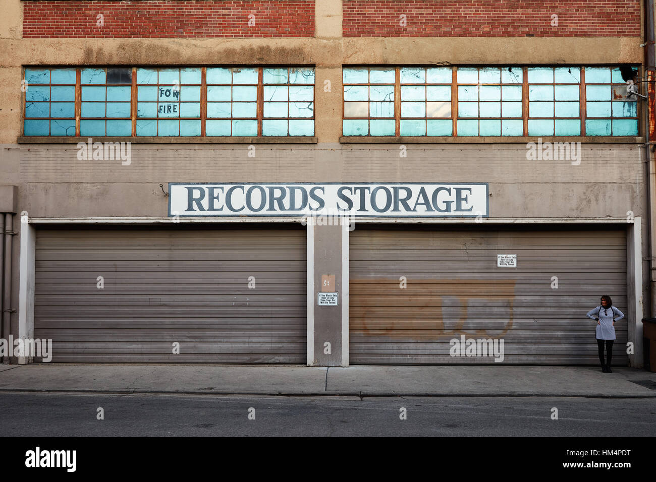 Old Records Storage building with large garage doors & Old Records Storage building with large garage doors Stock Photo ...