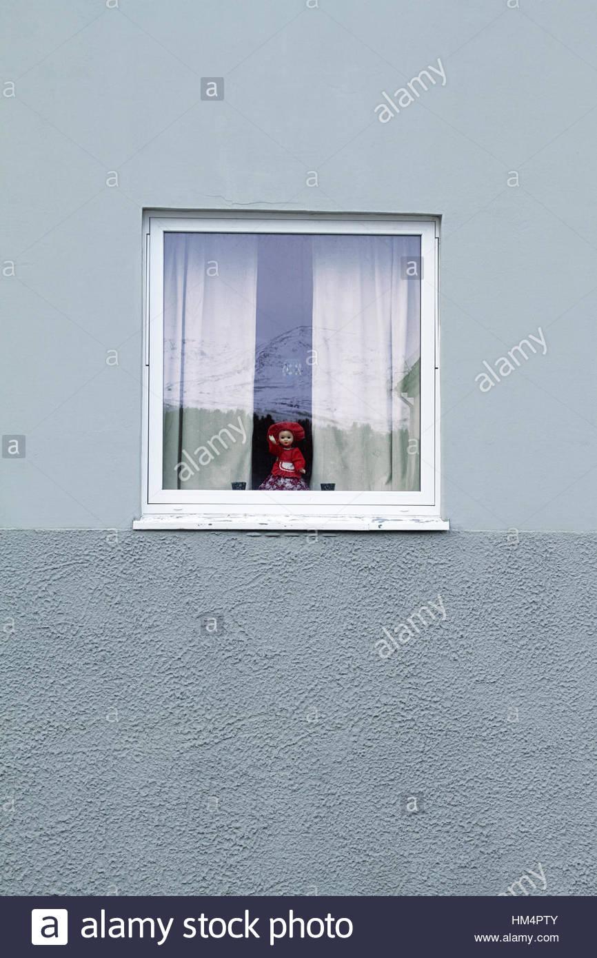 powderblue wall window reflection mountain curtain doll - Stock Image