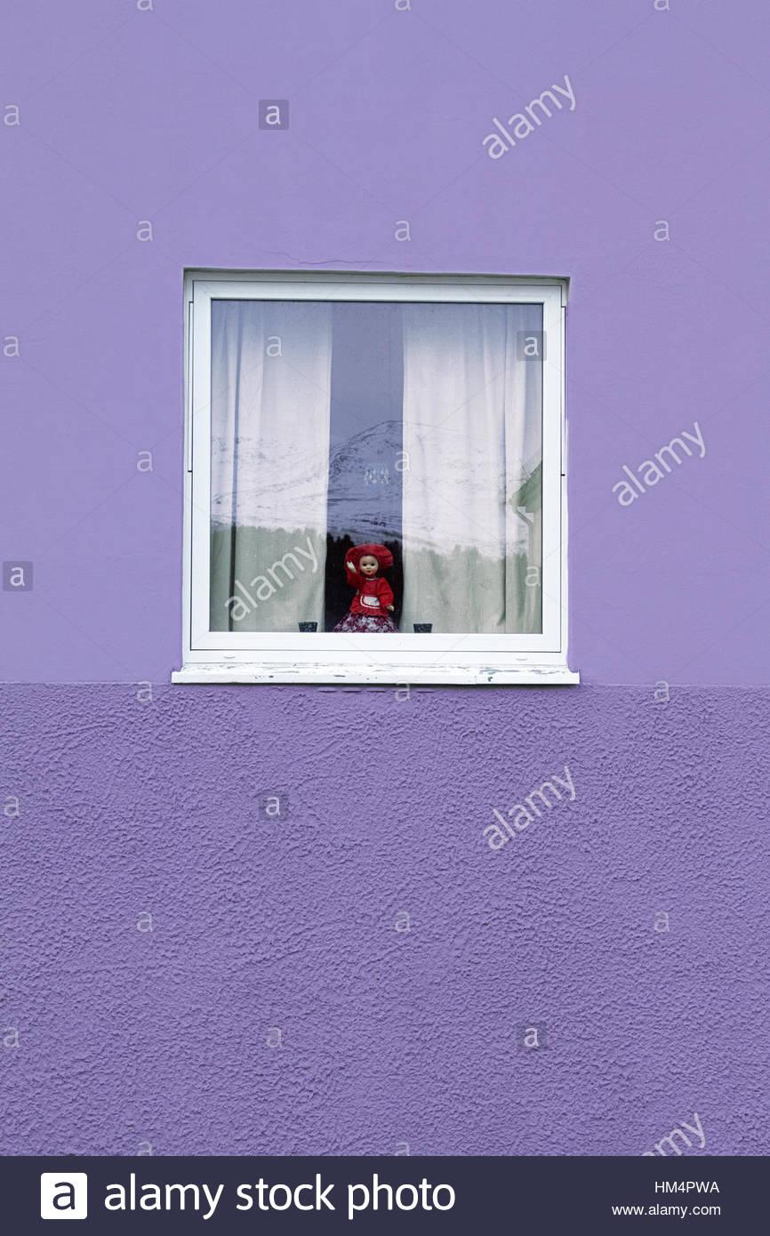 purple  wall window reflection mountain curtain doll - Stock Image