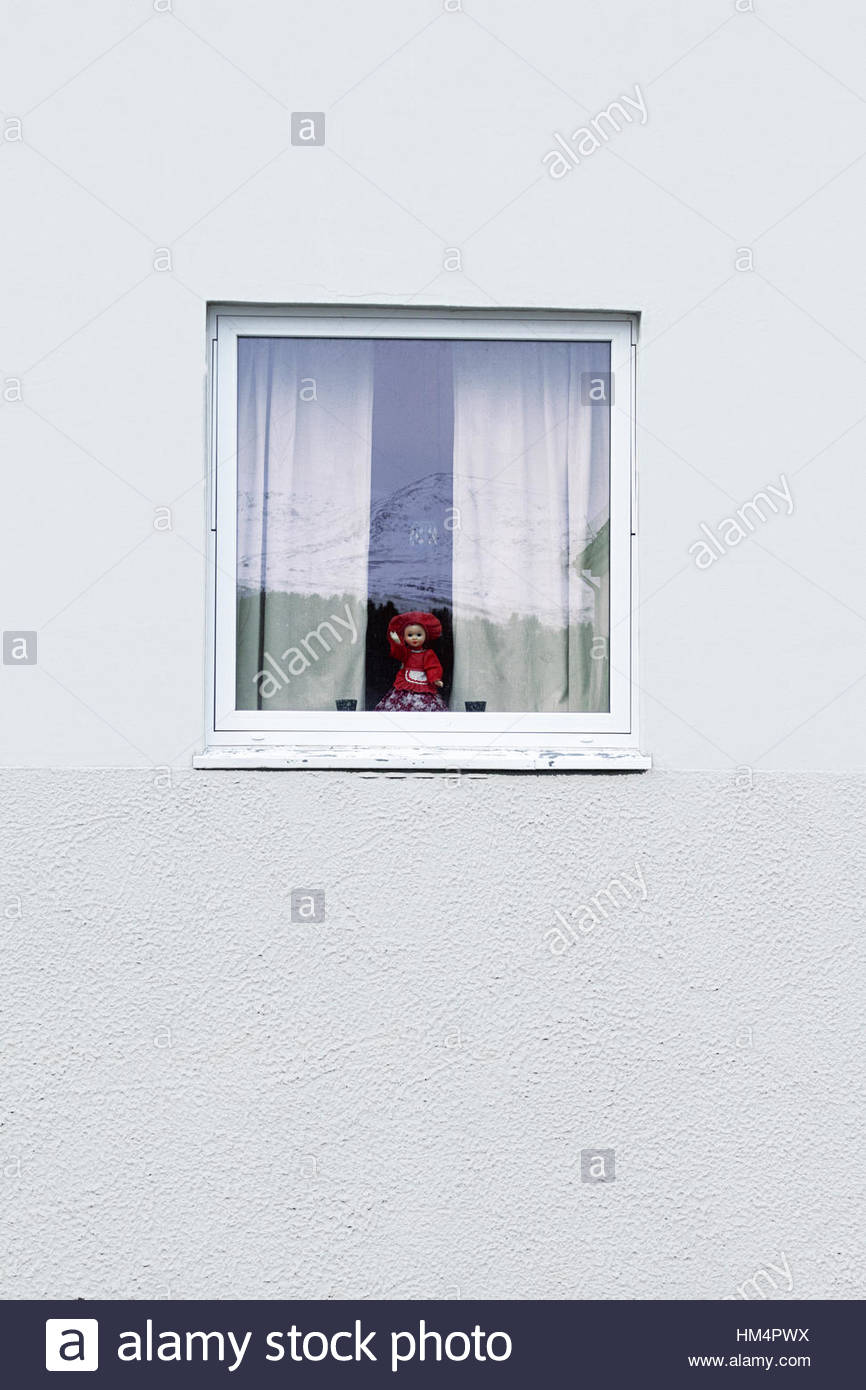 white wall window reflection mountain curtain doll - Stock Image