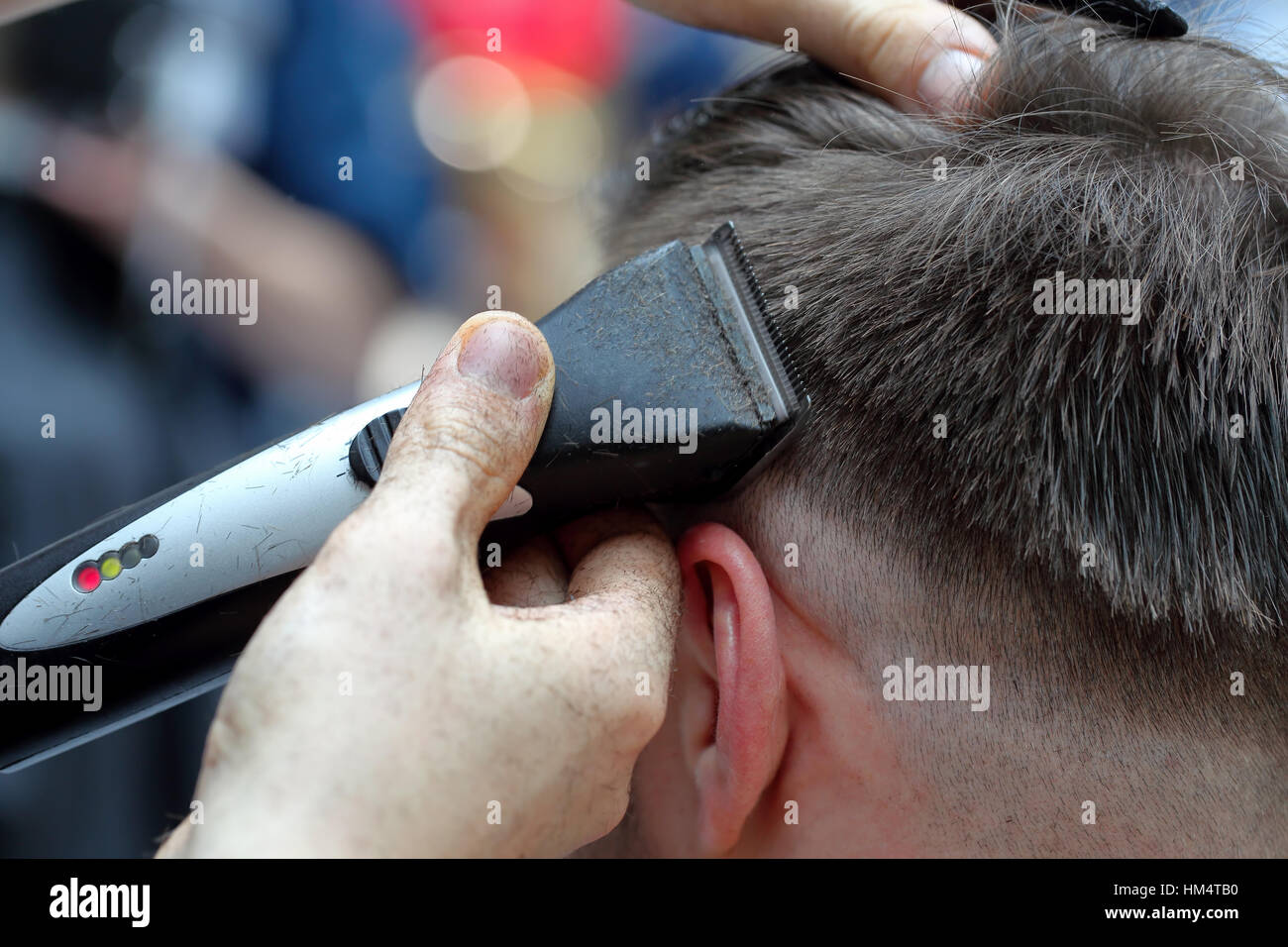 The client at the barber shop haircut by electric trimmer - Stock Image