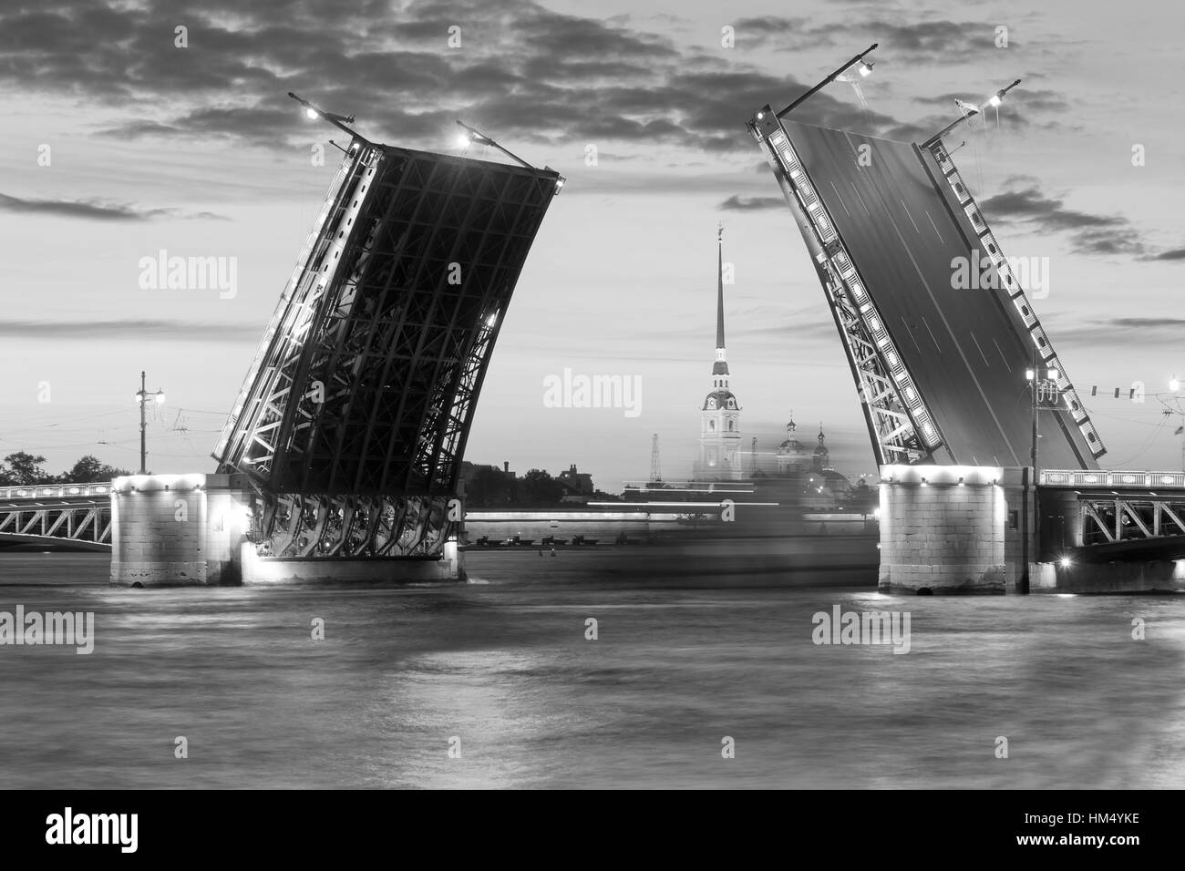 The raised Palace bridge at white nights in the city of St.-Petersburg , black-and-white image Stock Photo