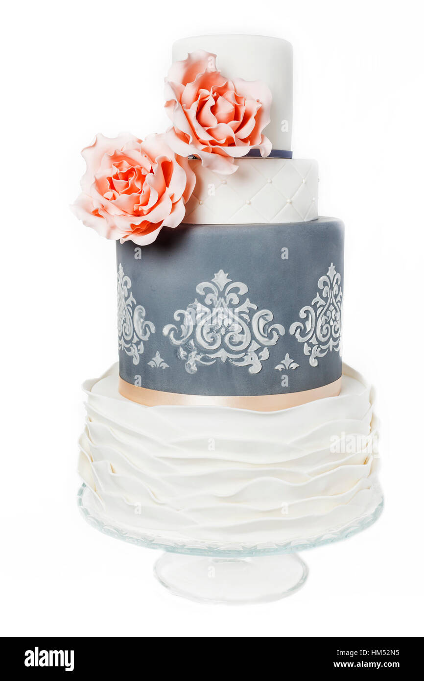 beautiful grey and white weddingcake with pink roses and pattern - Stock Image