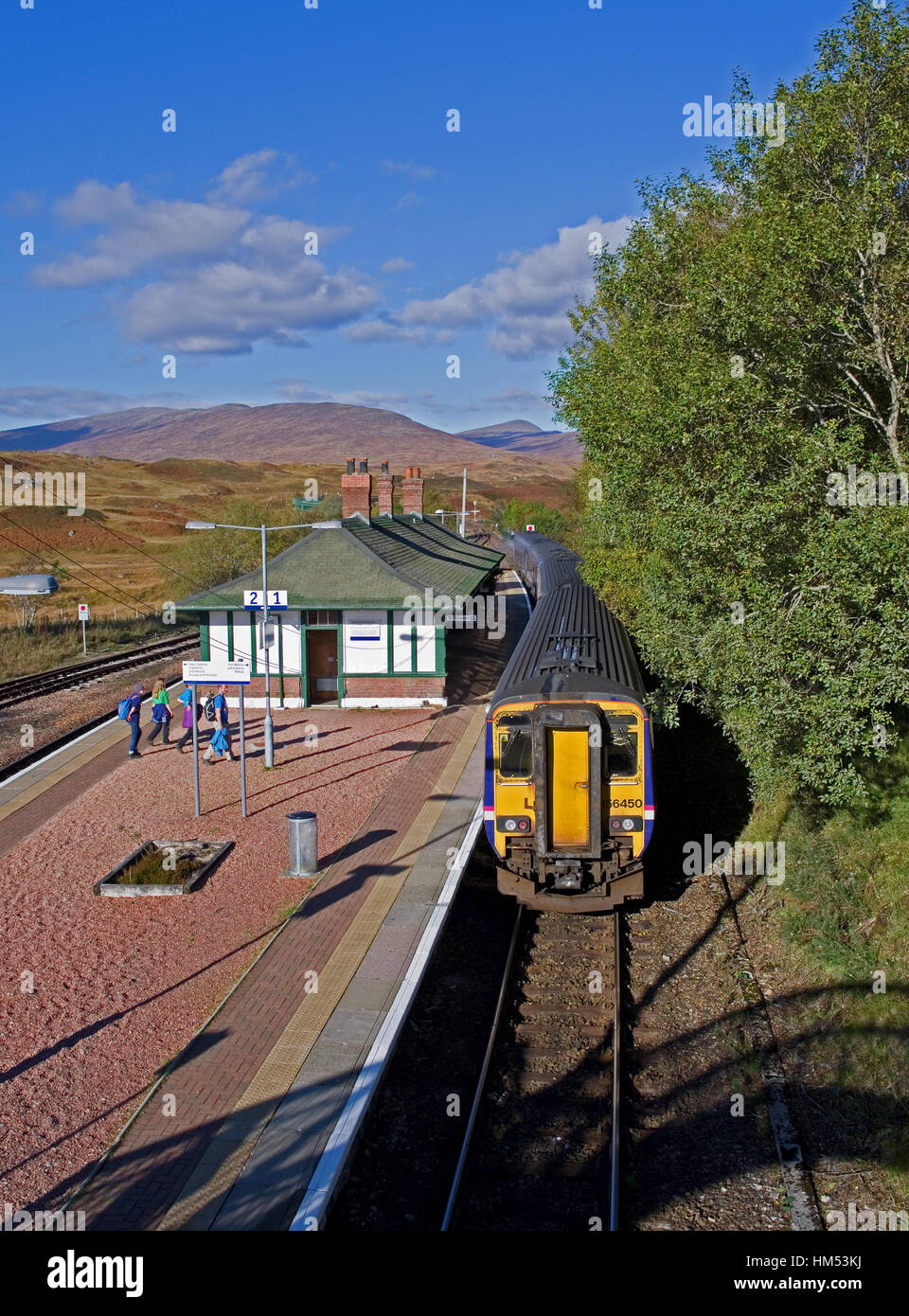 A northbound train waiting at the platform of Rannoch Railway Station, on the edge of Rannoch Moor, on a sunny autumn - Stock Image