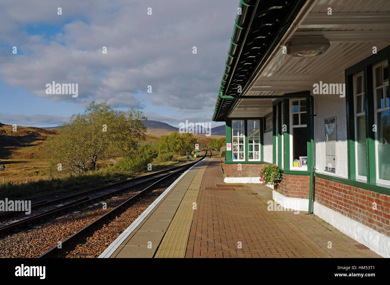 View along the platform at Rannoch Railway Station to the surrounding hills and moorland of Rannoch Moor, Perthshire, - Stock Image