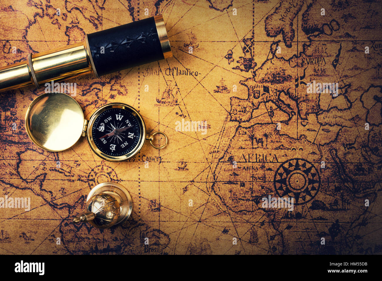 Vintage compass and spyglass on old world map copy space stock vintage compass and spyglass on old world map copy space gumiabroncs Images