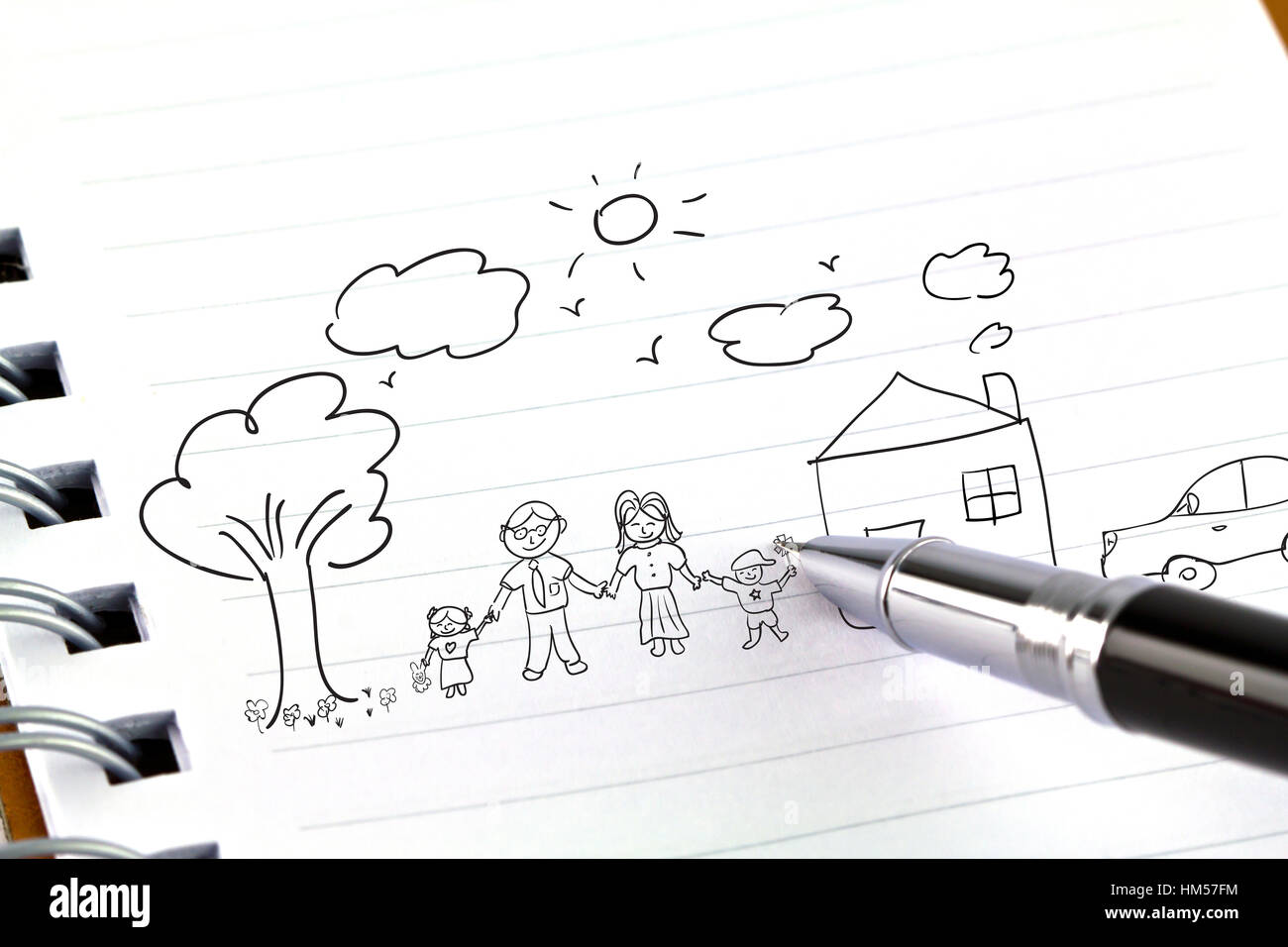Hand draw in open book of lovely family Stock Photo