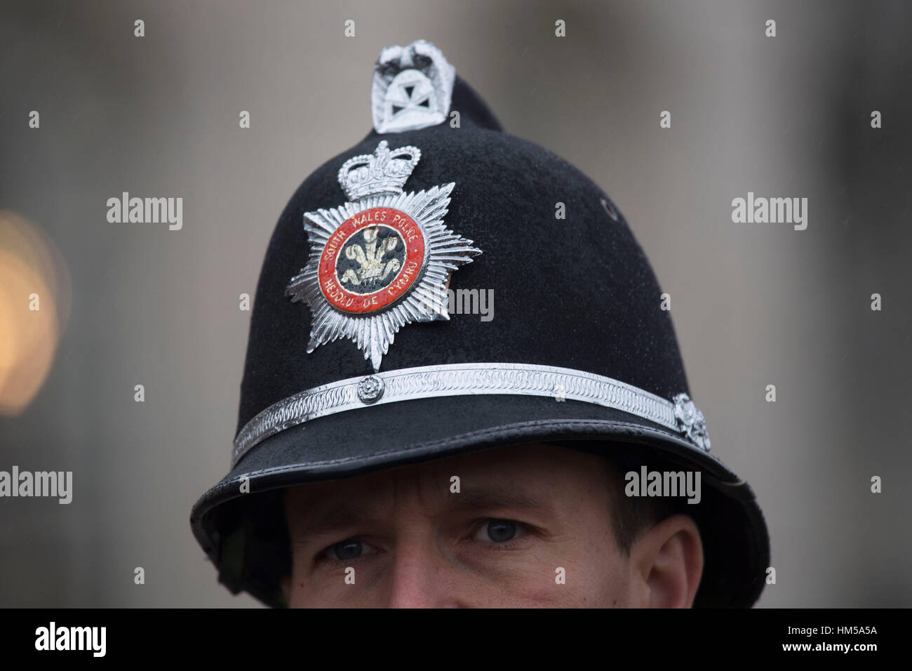 A south Wales police officer's helmet. - Stock Image