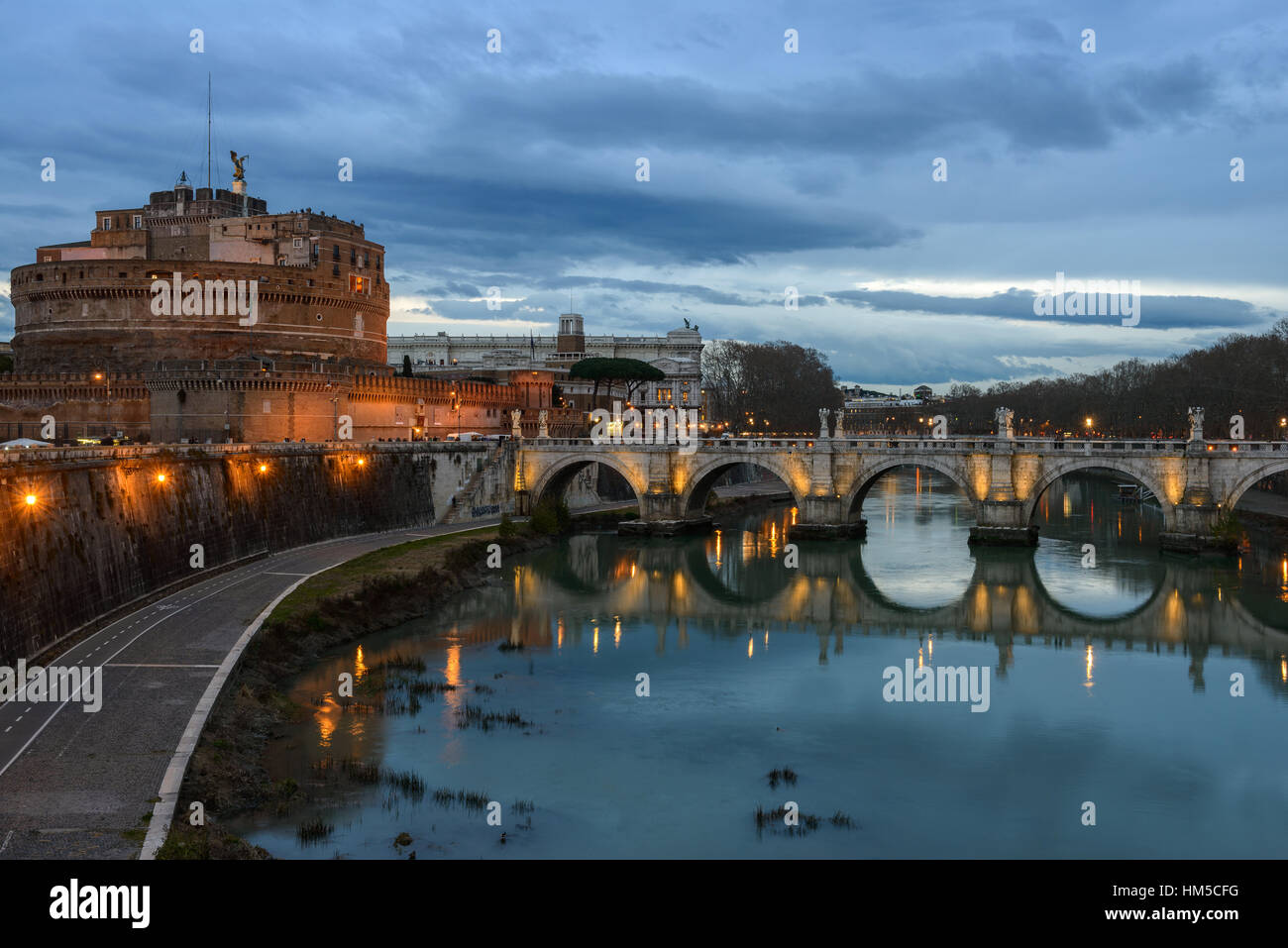 Night view at the river Tiber, castle and bridge San Angelo, Rome, Italy - Stock Image