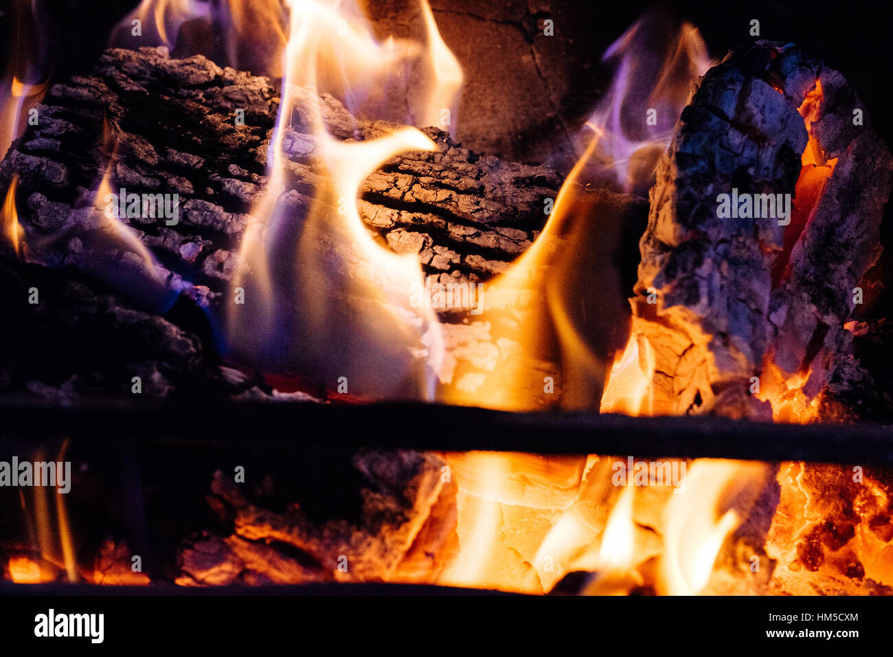 A close up fireplace showing logs and coal burning - Stock Image