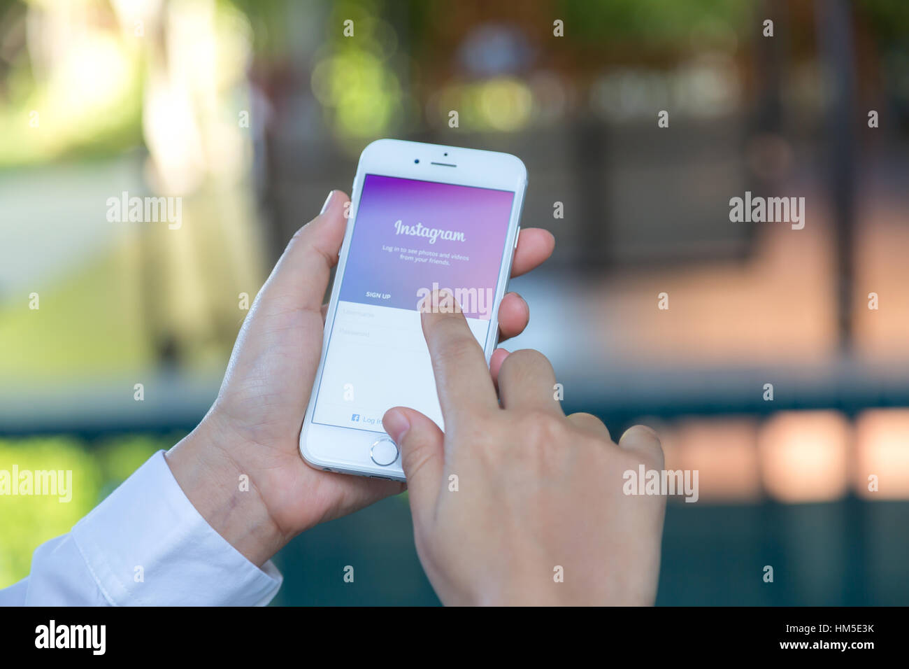 Loei, Thailand - August 12, 2015: Hand holding Iphone with mobile application for Instagram on the screen - Stock Image