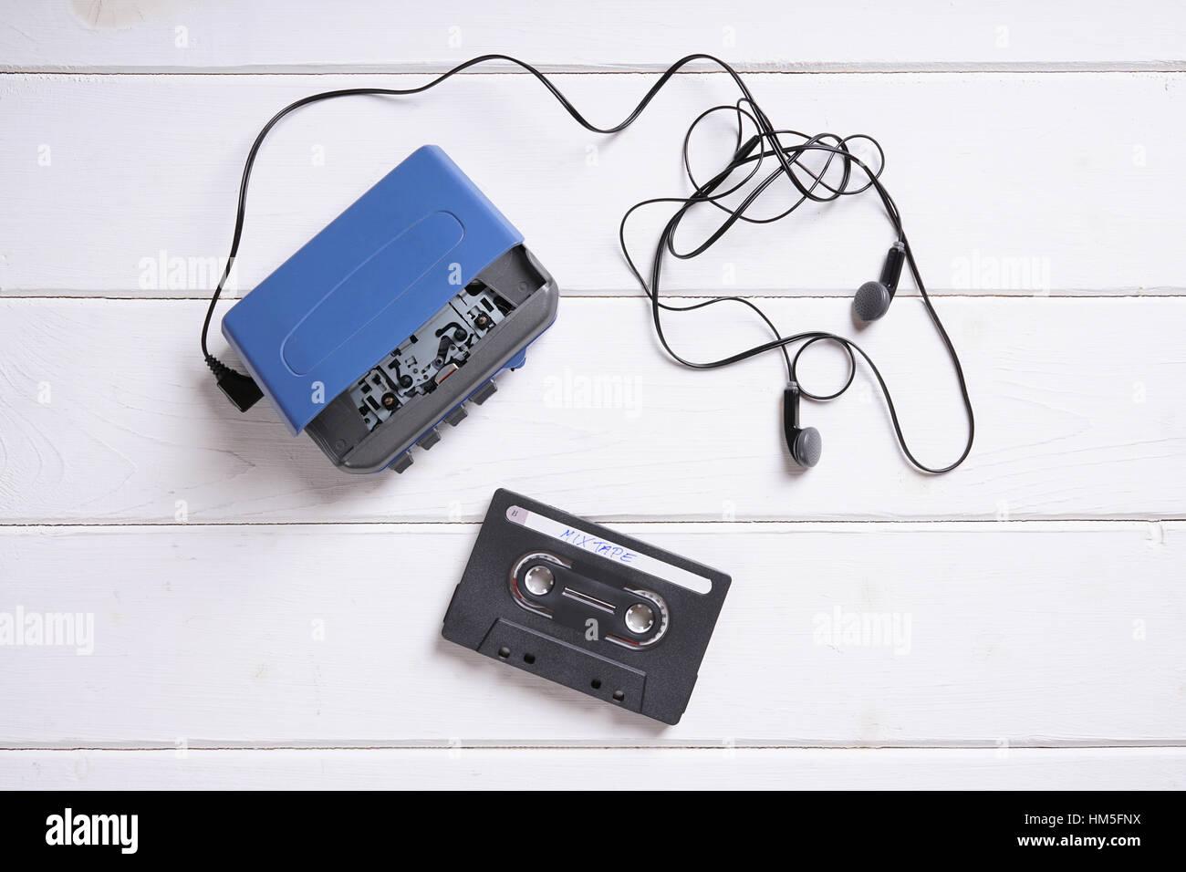 walkman with earphones and mixtape - Stock Image