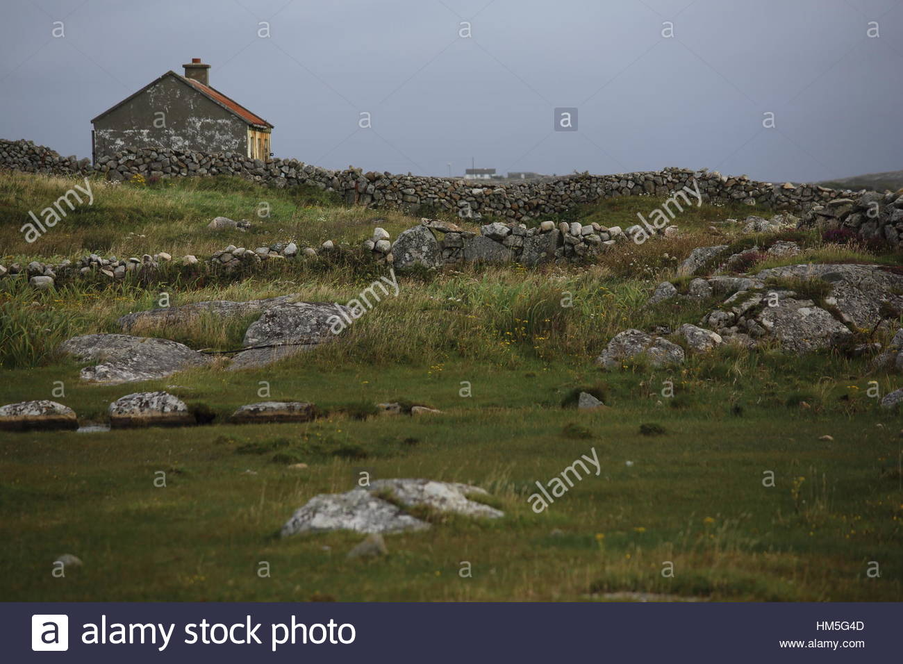Irish outhouse made of stone and stone walls in Galway, Ireland - Stock Image