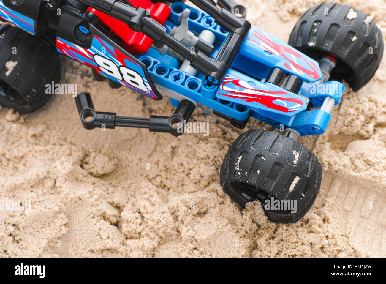 Tambov, Russian Federation - January 24, 2017 Lego Technic Off-road Racer on the sand. Some dust on the car. - Stock Image