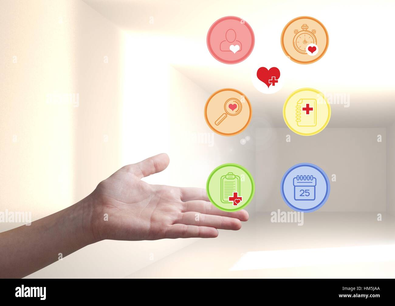 Hand showing digitally generated applications icon Stock Photo