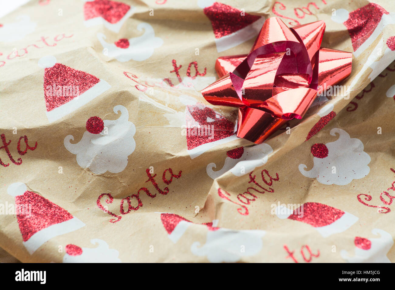 unrecyclable christmas wrapping paper with glitter and sellotape - Stock Image