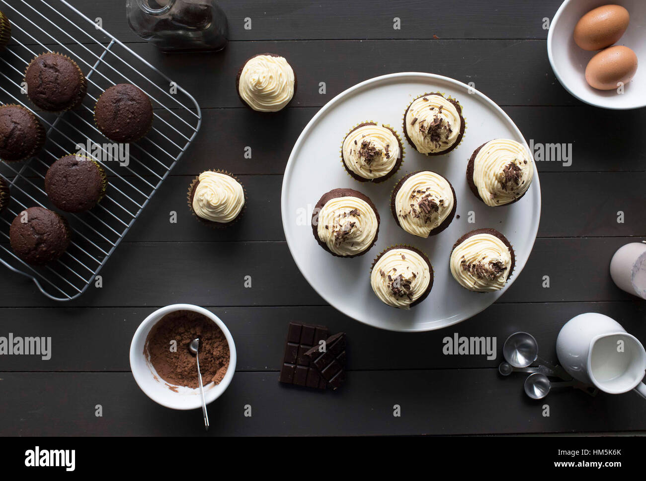 High angle view of cupcakes and chocolate chip muffins on table - Stock Image