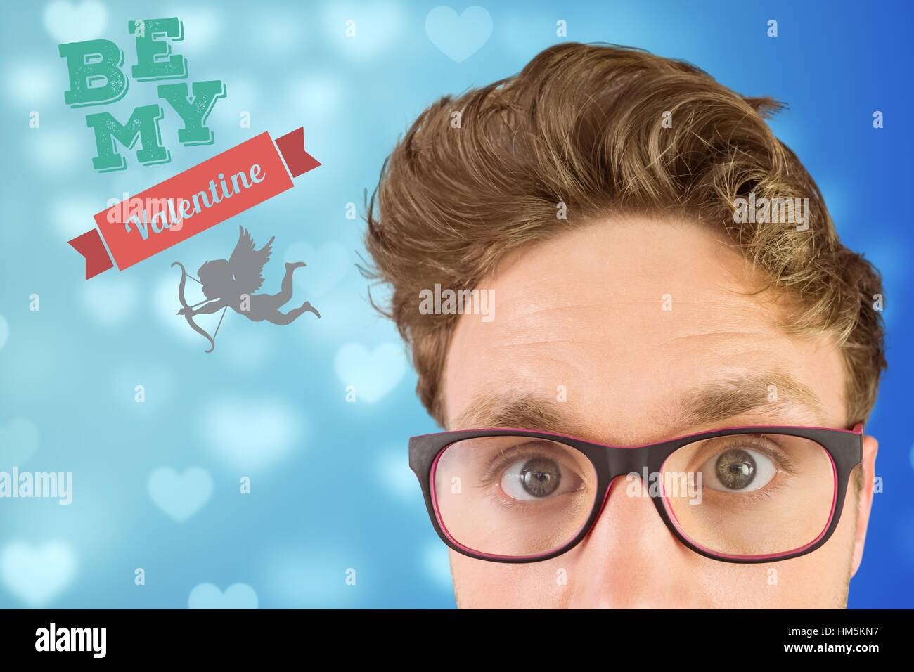 Digitally generated image of nerd man and valentine message - Stock Image