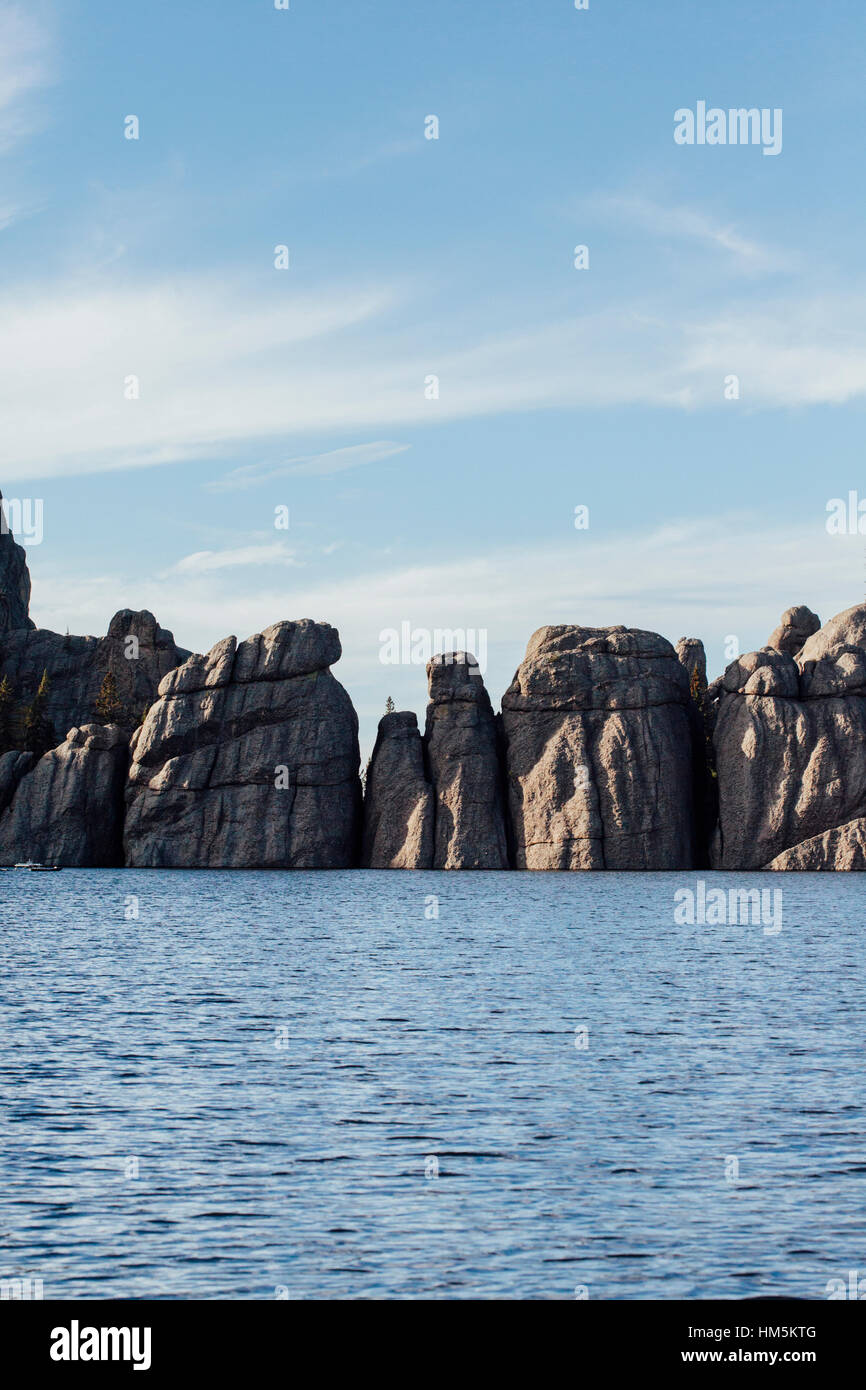 Sylvan lake and rock formation against sky at Custer state park - Stock Image