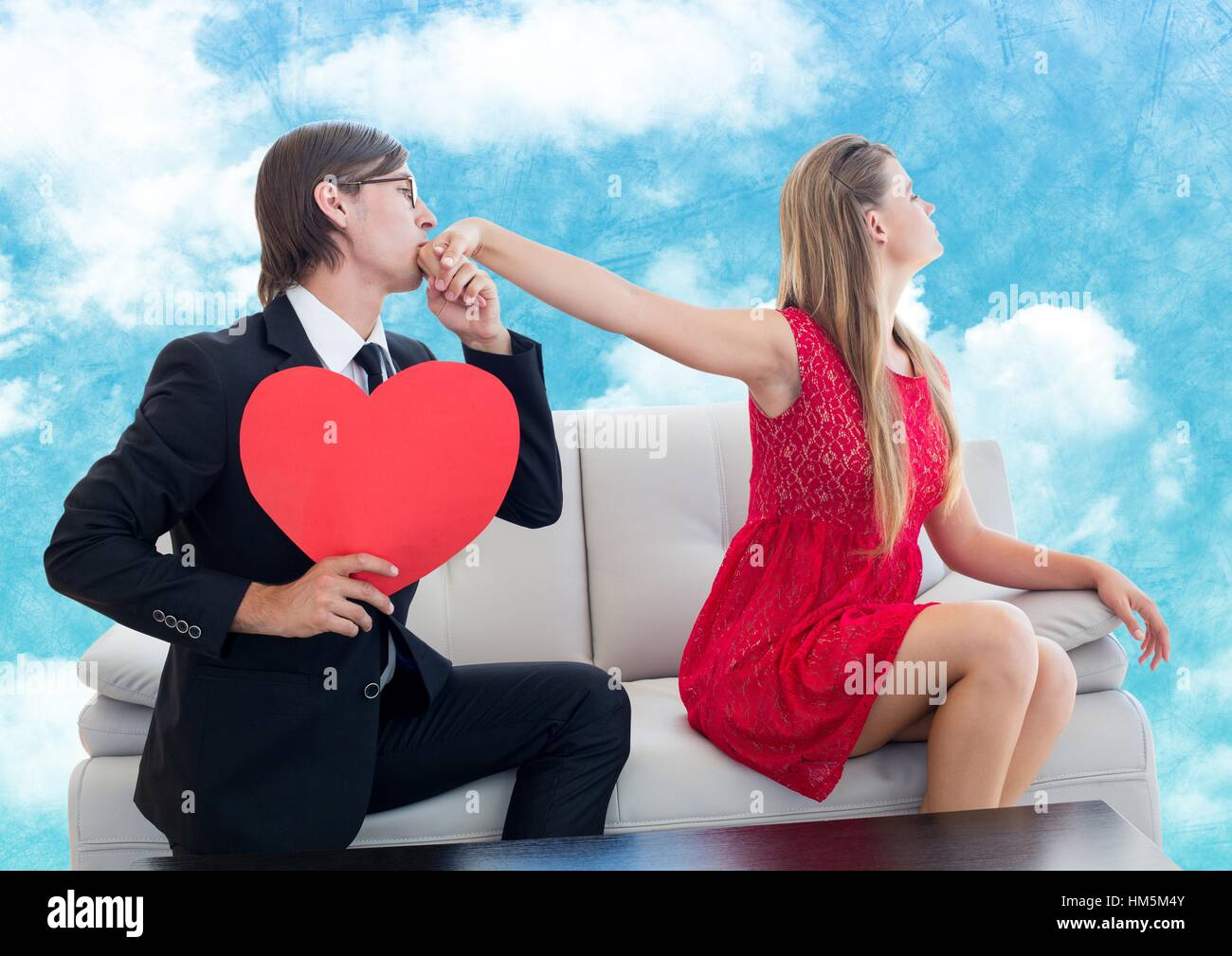 Man with red heart pleasing upset women - Stock Image