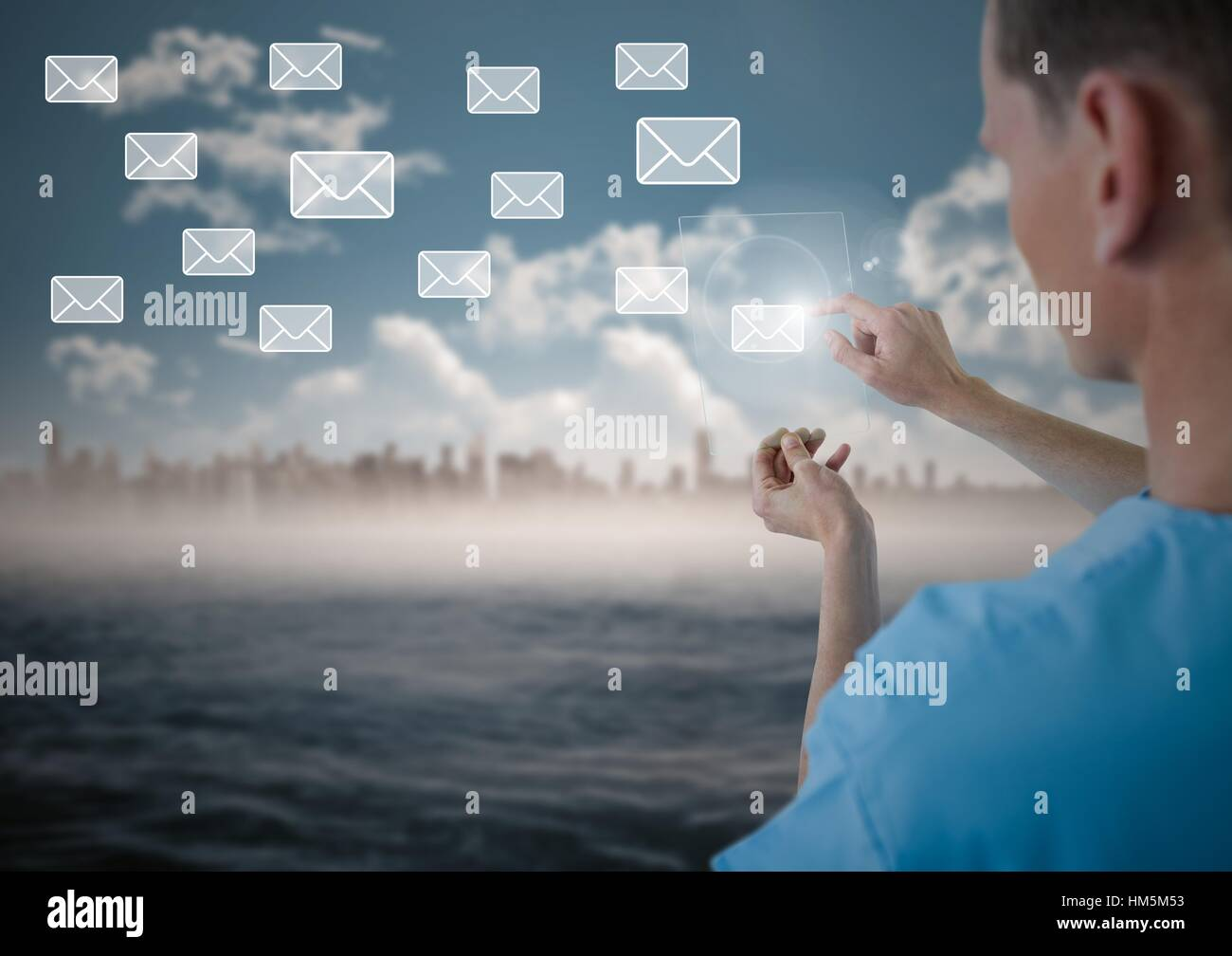 Doctor touching digitally generated email icon on virtual screen - Stock Image