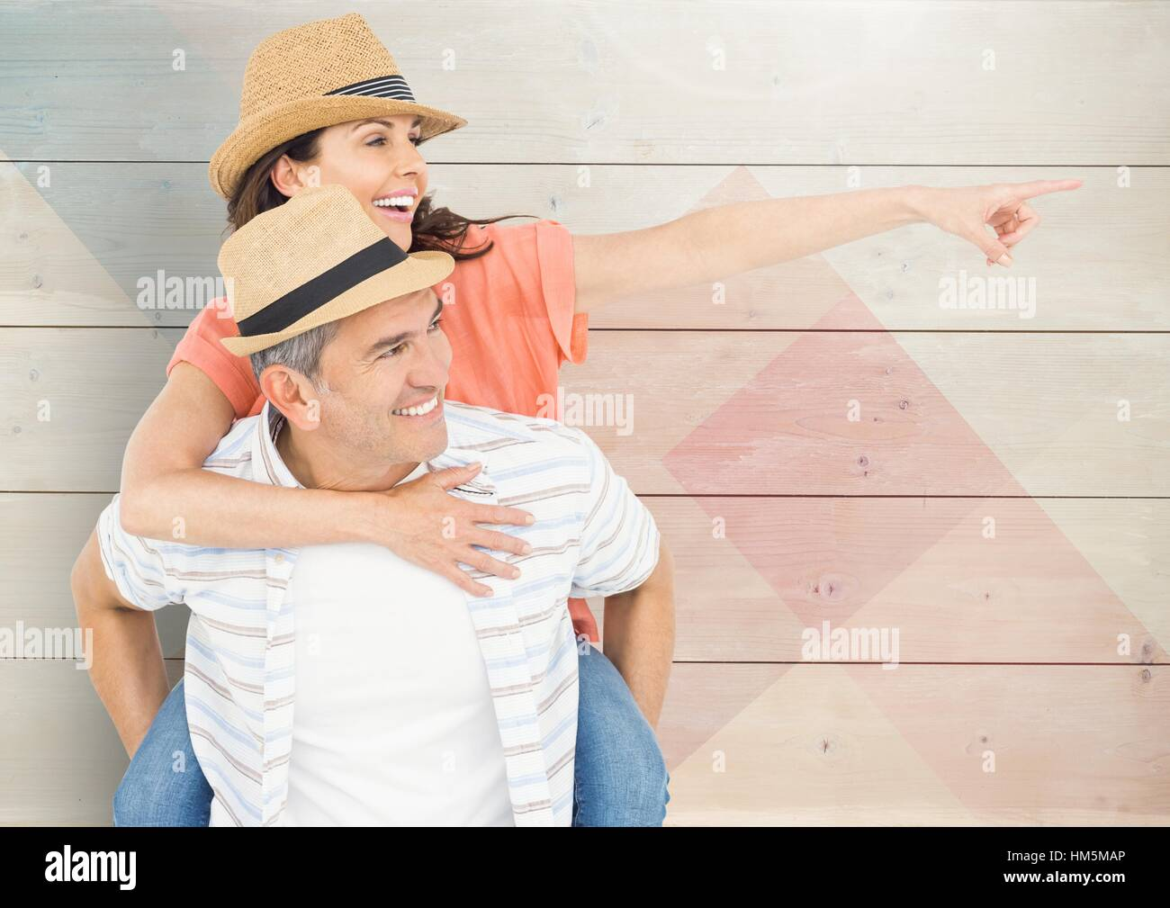 Composite image of mature man giving piggy back to woman - Stock Image