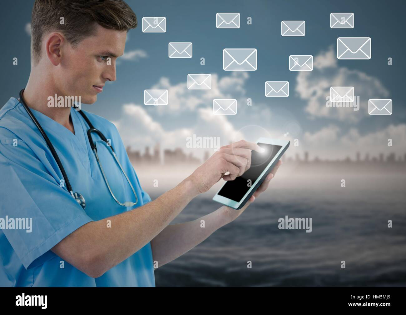 Doctor using digital tablet with digitally generated message icons - Stock Image