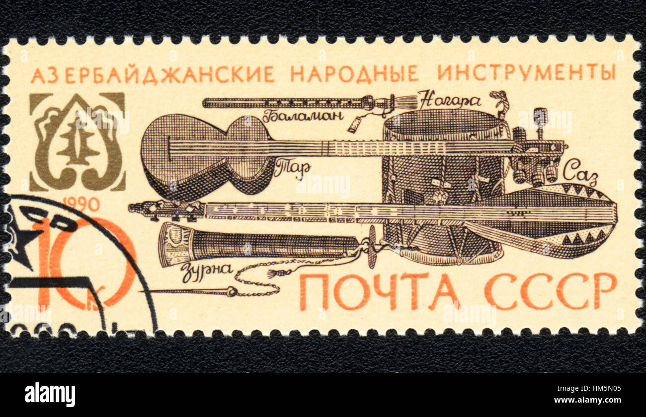 A postage stamp printed in USSR shows Azerbaijani folk musical instruments, 1990 - Stock Image