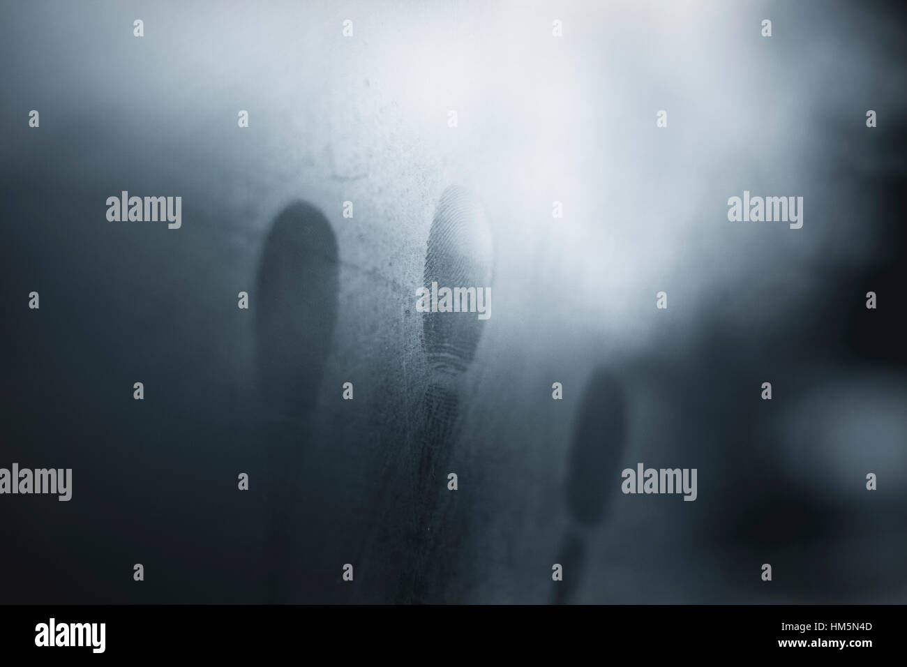 Close-up of fingerprints on condensed glass window - Stock Image