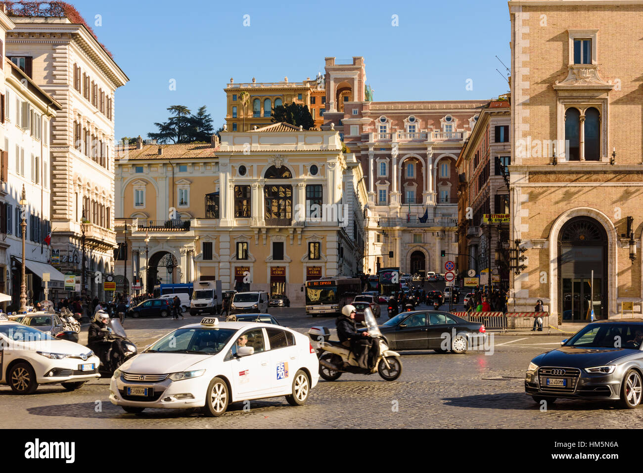 traffic can be seen crossing at an intersection on piazza venezia in rome italy - Stock Image