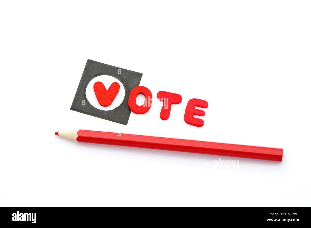 Red pencils and the word vote on a check box Stock Photo