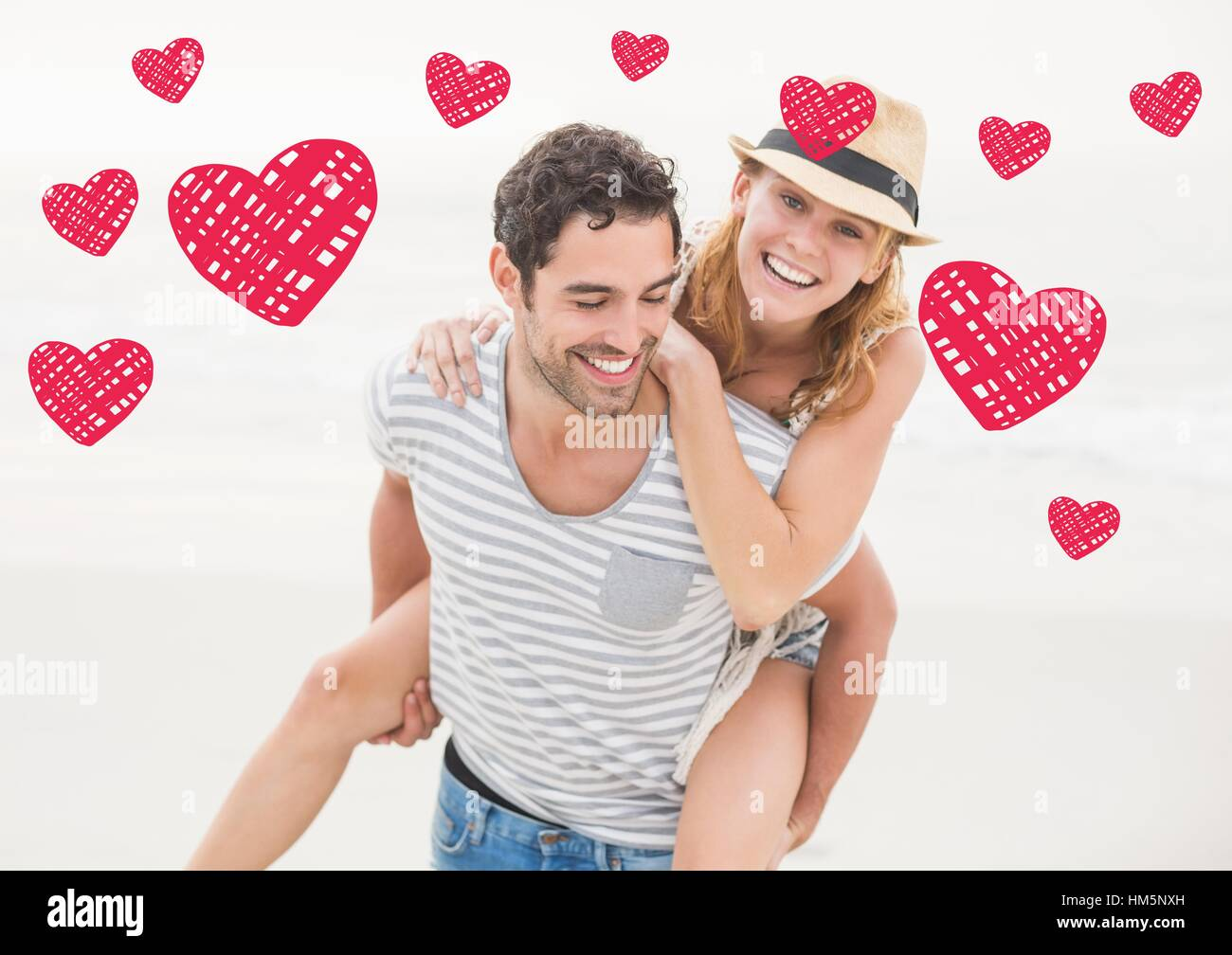 Happy man giving piggy back to woman against white background - Stock Image