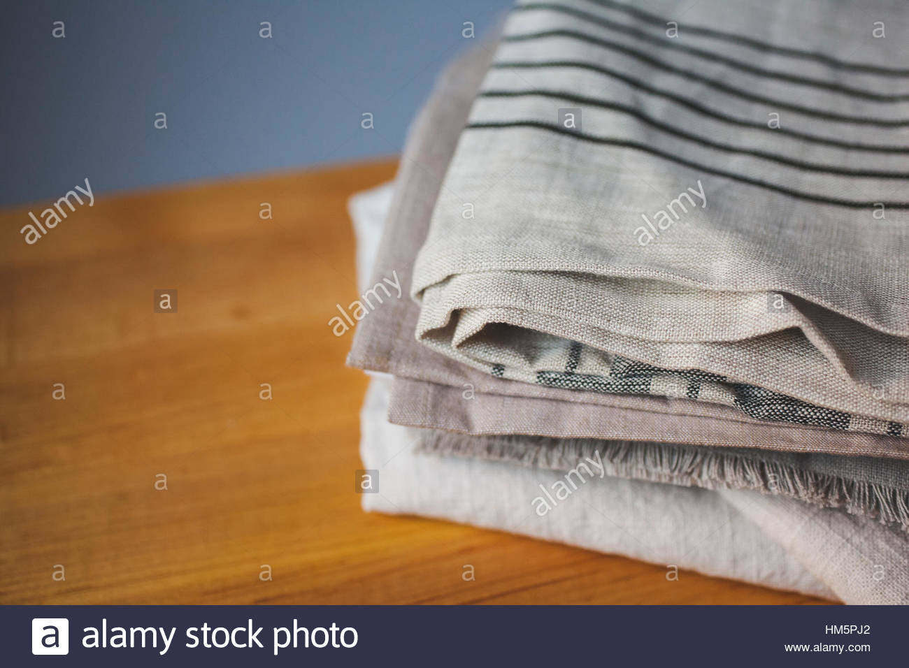 High angle view of tablecloths on wooden table - Stock Image