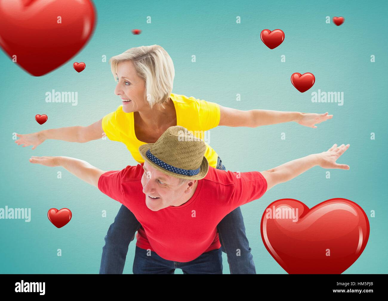Senior man giving piggy back to woman Stock Photo