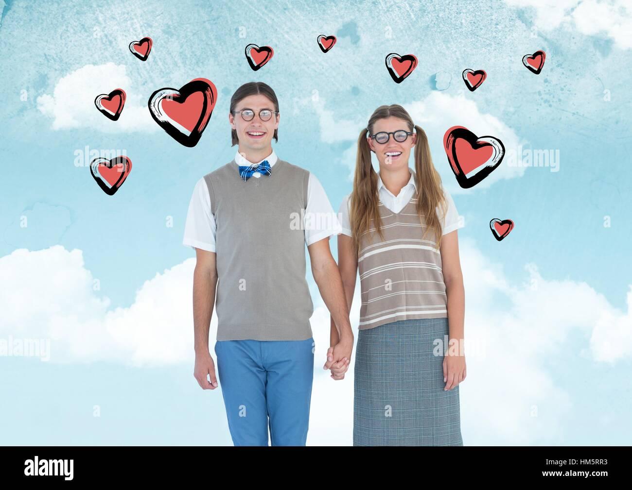 Nerd couple holding hands - Stock Image
