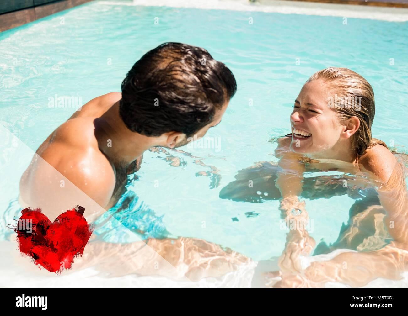 Couple having fun in swimming pool - Stock Image