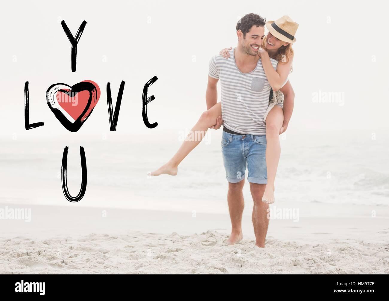 Happy man giving woman piggyback on beach - Stock Image