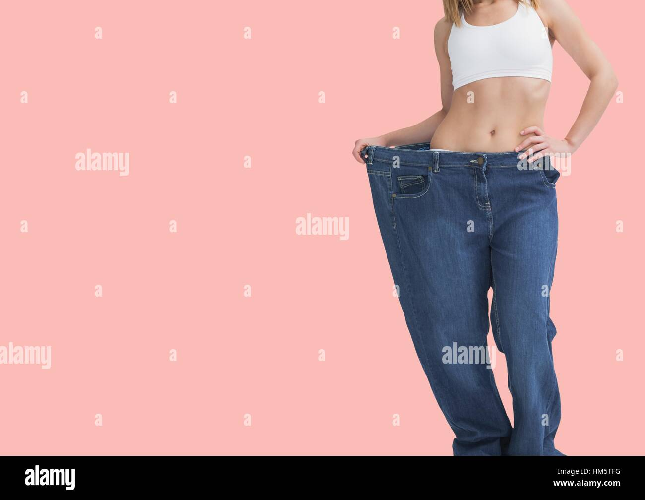Dieting woman in big pant - Stock Image
