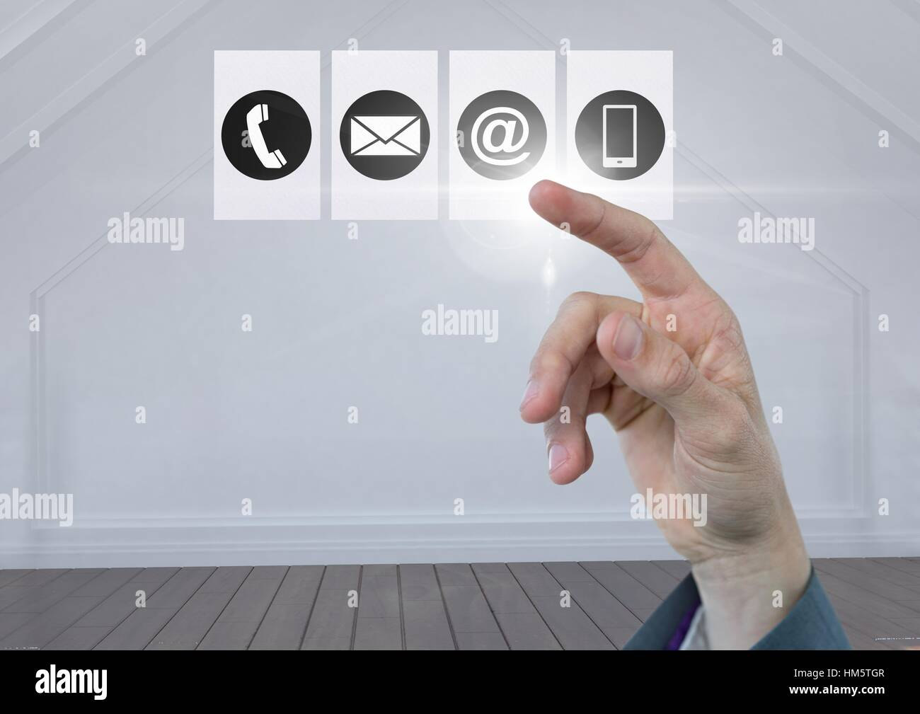 Businessperson touching digitally generated connecting icons - Stock Image