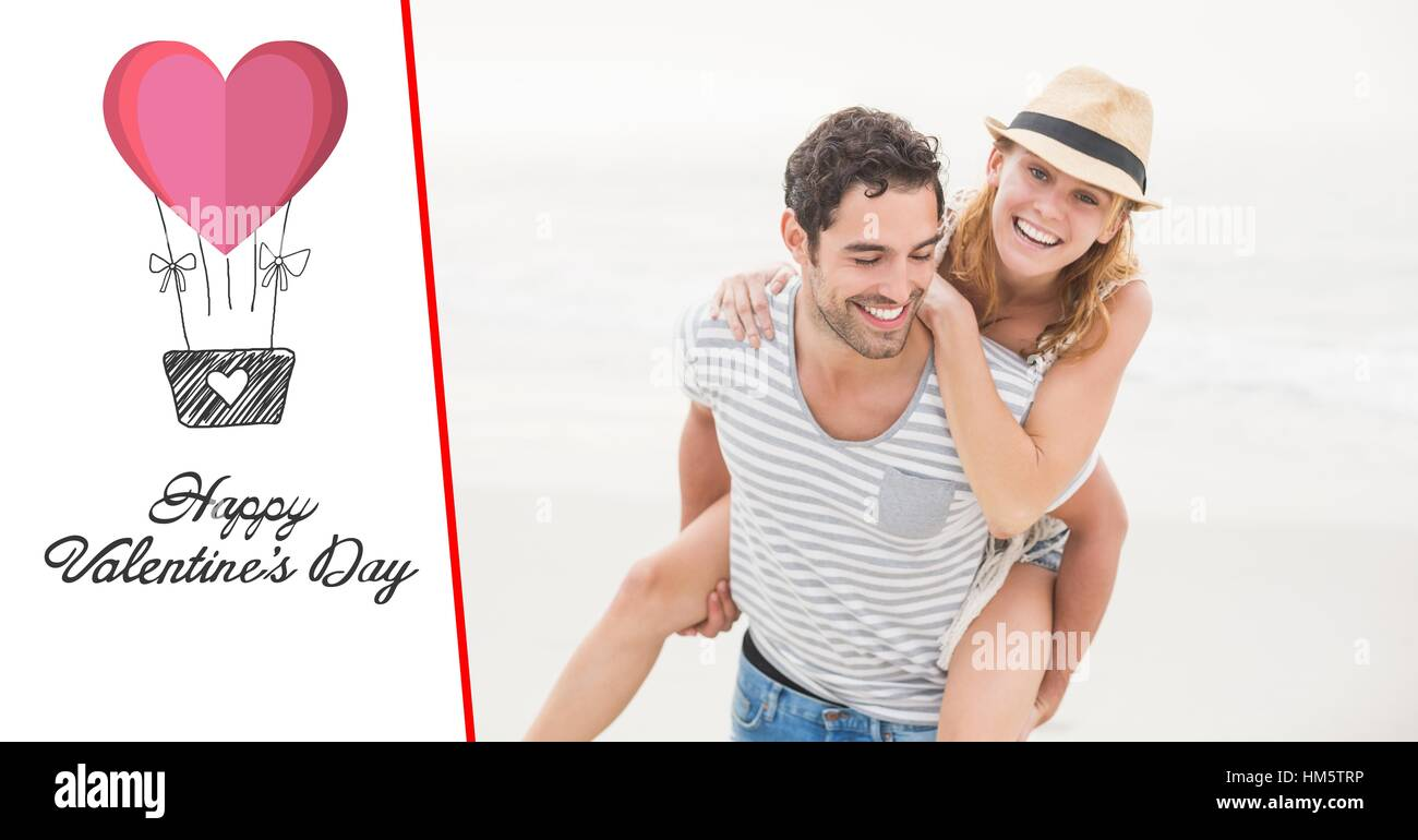 Happy man giving piggy back to woman against white background Stock Photo