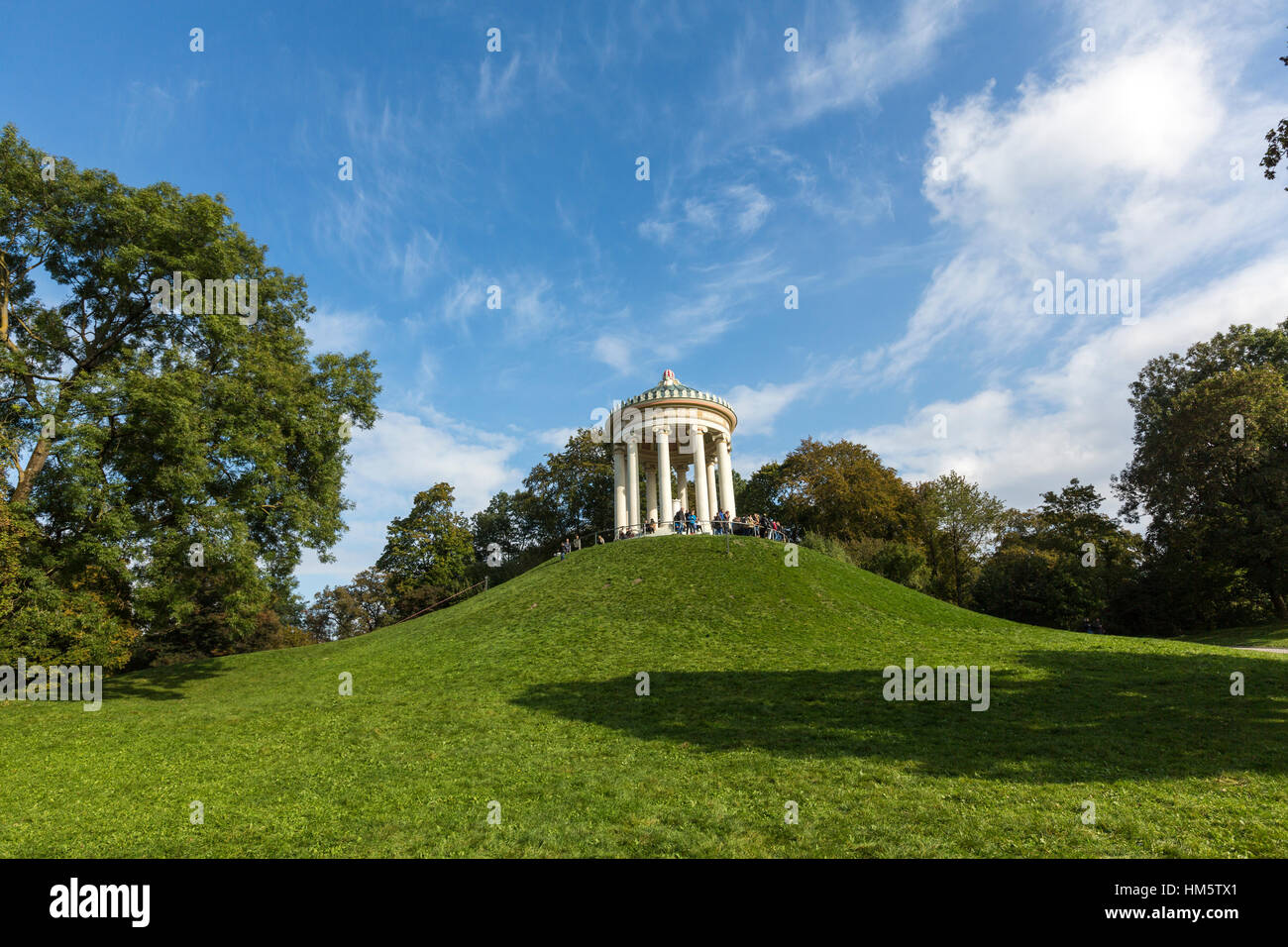 The Monopteros with tourists in Englischer Garten, English Garden, Munich, Germany - Stock Image