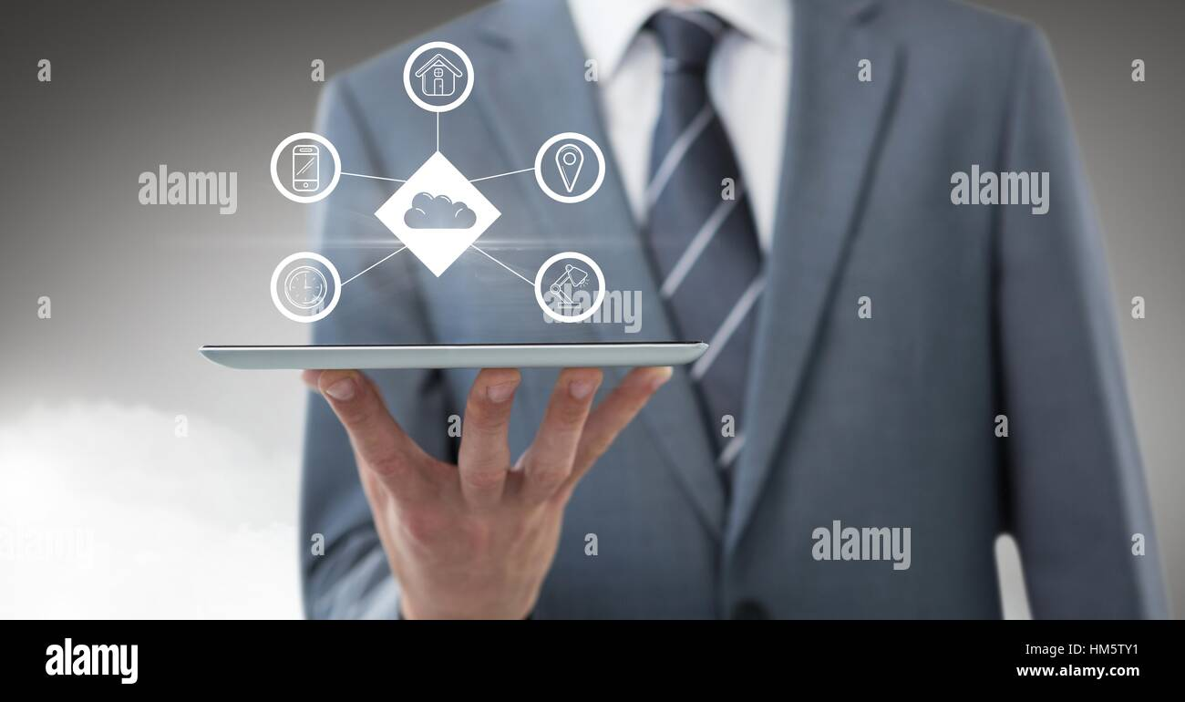 Businessman using digital tablet with app icon interface screen - Stock Image