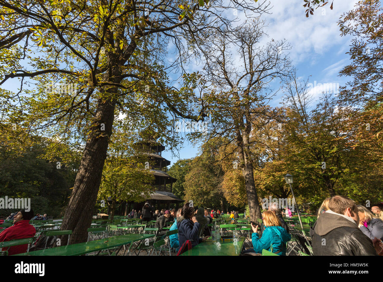 Tourists eating in the  Chinese Tower, Englischer Garten, English Garden, Munich, Germany - Stock Image