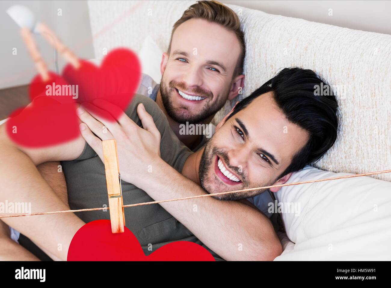 Homosexual couple embracing each other in bedroom at home Stock Photo