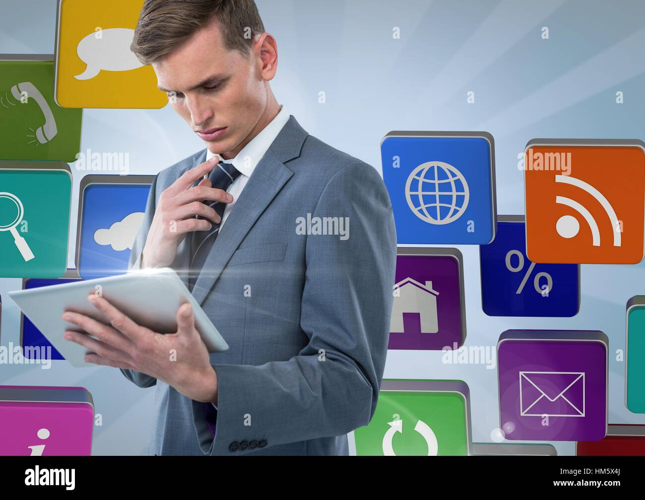 Businessman using tablet against applications icons Stock Photo
